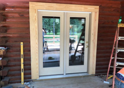 Newly installed door and trim on a recently stained home.