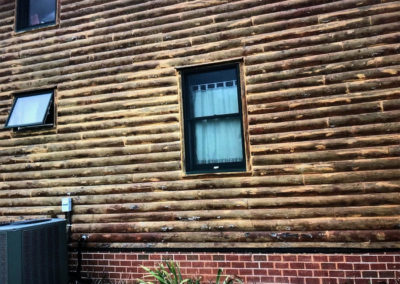 This is an example of a log home that has significant mold and mildew and the stain has deteriorated.  This house will need to be media blasted to remove those elements.
