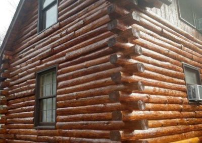 Log home after restoration and staining process is completed